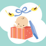 Wonderful Baby in a Gift Box. Illustration of a baby in a gift box with two birds holding ribbon Stock Photo