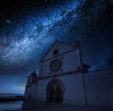 Wonderful basilica in Assisi at night with stars, Umbria, Italy Royalty Free Stock Image