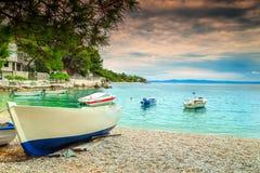 Wonderful bay with motorboats, Brela, Dalmatia region, Croatia, Europe. Amazing harbor with fishing boats, Adriatic Sea and majestic bay on Brela resort Stock Photography