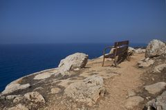 A wonderful bench on the precipice royalty free stock image