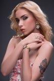 Wonderful blonde wearing jewelry Stock Photo