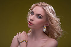 Wonderful blonde wearing jewelry Stock Image