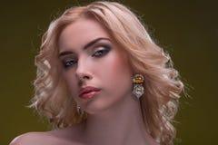 Wonderful blonde wearing jewelry Stock Photography