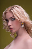 Wonderful blonde wearing jewelry Stock Images