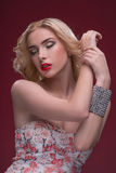 Wonderful blonde wearing jewelry Royalty Free Stock Image