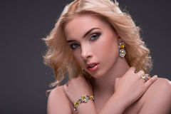 Wonderful blonde wearing jewelry Royalty Free Stock Photos