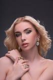 Wonderful blonde wearing jewelry Royalty Free Stock Image