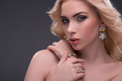 Wonderful blonde wearing jewelry Royalty Free Stock Photography
