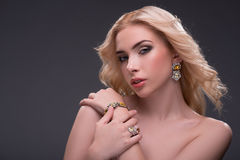 Wonderful blonde wearing jewelry Royalty Free Stock Images