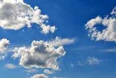 Wonderful blue sky, with some white. Clouds Royalty Free Stock Image