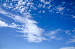 Wonderful blue sky, with some white clouds. White fluffy clouds in the blue sky Stock Images