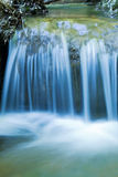 Wonderful blue waterfall. In the mountains royalty free stock photo