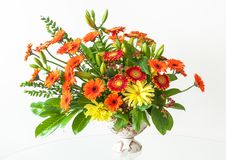 A Wonderful Bouquet of Mixed Colorful Gerberas in an Antique Vase. stock images