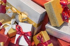 Wonderful boxed Christmas presents with a ribbon.  Stock Photos