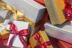 Wonderful boxed Christmas presents with a ribbon.  stock image