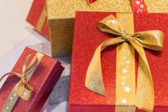 Wonderful boxed Christmas presents with a ribbon.  Stock Images