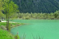 The wonderful Braies lake in the Dolomites in spring with the mountains still covered in snow. Italy is a country with many wonderful places and the Dolomites Royalty Free Stock Photos