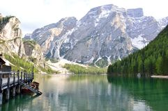 The wonderful Braies lake in the Dolomites in spring with the mountains still covered in snow. Italy is a country with many wonderful places and the Dolomites Stock Photos