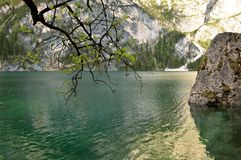 The wonderful Braies lake in the Dolomites in spring with the mountains still covered in snow. Italy is a country with many wonderful places and the Dolomites Stock Images