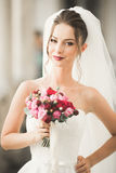 Wonderful bride with a luxurious white dress posing in the old town stock photography