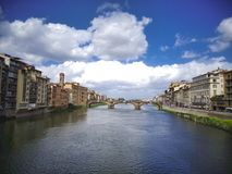 wonderful bridge over the river with clouds royalty free stock photo