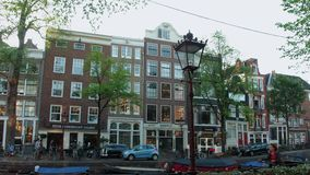 Wonderful buildings at the canals of Amsterdam - typical street view - AMSTERDAM - THE NETHERLANDS - JULY 19, 2017. Wonderful buildings at the canals of stock footage
