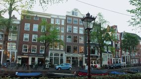Wonderful buildings at the canals of Amsterdam - typical street view. AMSTERDAM - HOLLAND stock video