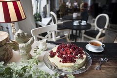 Wonderful cake with Belgian white chocolate on the background of a vintage restaurant royalty free stock photo