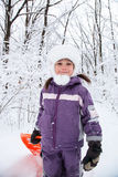 Wonderful child in the snowy woods Stock Images