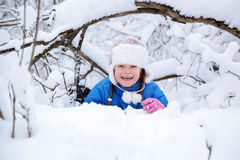 Wonderful child in the snowy woods Stock Photos