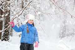 Wonderful child in the snowy woods Stock Image