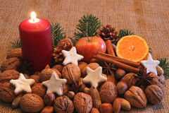 Wonderful Christmas time. Nuts, fruits and biscuits to Christmas time Stock Photos