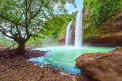 Wonderful Cikaso waterfall scenery. Picture of wonderful Cikaso waterfall scenery in the tropical forest at Sukabumi, Indonesia royalty free stock photography