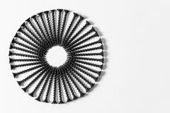 Wonderful circle of black screws, set one by one, on a white background royalty free stock photos