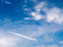 A wonderful clear sky outside with clouds streaks and lush blues Stock Images