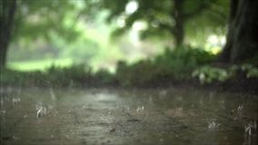 Wonderful close up satisfying steady slow motion shot of downpour rain drops falling on pavement asphalt concrete road. Wonderful close up steady satisfying slow stock video