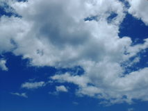 Wonderful clouds in the blue bright sky Stock Photos