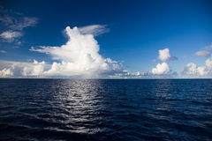 Wonderful clouds over the blue Indian Ocean Stock Photo