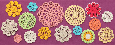 The wonderful colored crochet doilies Stock Photos