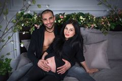 Wonderful couple of muslim man and his beautiful pregnant wife, Royalty Free Stock Image