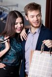 Wonderful couple is in the shopping mall. And happy that they bought a lot of things at cut rates Stock Images