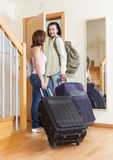 Wonderful couple together with their luggage leaving home Royalty Free Stock Photo