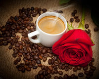 Wonderful cup of hot coffee and red rose Royalty Free Stock Image