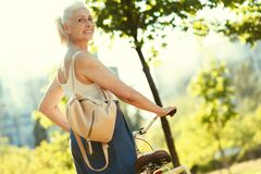 Nice delighted woman being outdoors Stock Photos