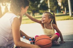 Wonderful day to play mom. Mother and daughter on playground royalty free stock images