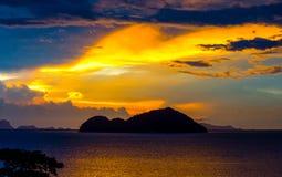 WONDERFUL DRAMATIC TWILIGHT SKY CLOUD ABOVE ISLAND AND Stock Photo