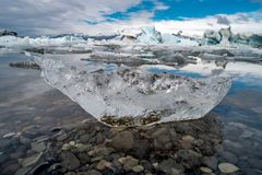 Wonderful dramatic view of oceanic black sand beach with ice from Glacier Lagoon, Jokulsarlon, Iceland, summer time stock photo