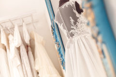 Wonderful dresses for future bride in workshop Stock Images