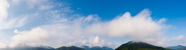 Wonderful dynamic cloudscape above the mountains. Wonderful dynamic cloudscape above the mountain ridge. beautiful panoramic nature background royalty free stock images