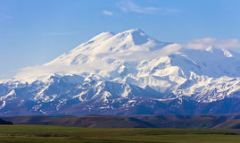 Wonderful Elbrus in light clouds. The Caucasus. Stock Photography